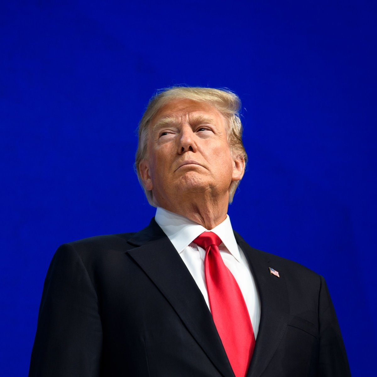 TOPSHOT - US President Donald Trump looks on before delivering a speech during the World Economic Forum (WEF) annual meeting on January 26, 2018 in Davos, eastern Switzerland.  / AFP PHOTO / Fabrice COFFRINI        (Photo credit should read FABRICE COFFRINI/AFP/Getty Images)