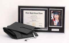 Image of a cap and gown and a diploma frame
